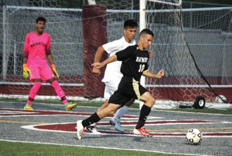 Woodland's Christian Poirier (10) looks for room to work in front of goal as Naugatuck's Gabriel Carrelo defends Sept. 16 in Naugatuck. Naugatuck won the game, 1-0. –ELIO GUGLIOTTI
