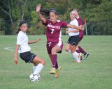 Naugatuck's Alyana Sosa (7) gets past Woodland's Julia Accetura Sept. 16 in Beacon Falls. Woodland won the game, 5-0. –ELIO GUGLIOTTI