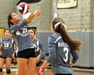 Naugatuck's Molly Kennedy (21) and the Greyhounds are proving they can play with the top teams in the NVL. The Greyhounds' three losses this season have all gone to a fifth set. –FILE PHOTO