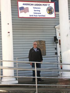 American Legion Post 17 Commander Ron Fischer stands in front of the post on Cedar Street in Naugatuck. Fischer, a 74-year-old veteran, is working to increase the legion's membership. –LUKE MARSHALL