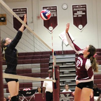 Naugatuck's Olivia Rotatori (10) and Woodland's Emily Brouillette play the ball at the net Tuesday in Naugatuck. Woodland won the match, 3-1. Woodland won the match, 3-1. –ELIO GUGLIOTTI