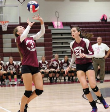 Naugatuck's Kelly Murphy (3) sets the ball as Taylor Hyde (10) keeps her eye on the action Tuesday night versus Woodland in Naugatuck. Woodland won the match, 3-1. –ELIO GUGLIOTTI
