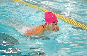 Woodland's Taylor Amore does the breaststroke during the 200 medley relay against St. Paul Oct. 14 in Beacon Falls. Woodland won the meet, 88-78. –ELIO GUGLIOTTI