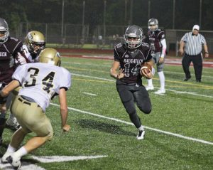 Naugatuck running back Tyler Deitelbaum (14) is a versatile weapon for the Greyhounds. The senior has 764 yards rushing, 87 yards receiving and nine total touchdowns, including a touchdown pass, in nine games this season. –ELIO GUGLIOTTI
