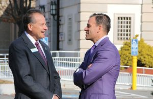 Ion Bank President and CEO Charles Boulier III, left, and Project Purple founder and CEO Dino Verrelli talk Nov. 17 outside of Ion Bank on Church Street in Naugatuck. The Ion Bank Foundation recently created a fund to help people battling pancreatic cancer. Project Purple will oversee the fund. –LUKE MARSHALL