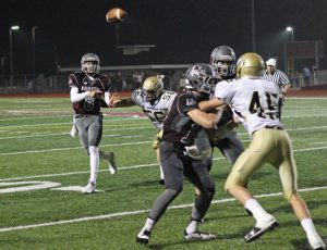 Naugatuck junior quarterback Mike Plasky (8), who has thrown for 1,923 yards and 23 touchdowns this year, will lead the Greyhounds on Thanksgiving as they seek their first win over Ansonia since 2010. –ELIO GUGLIOTTI