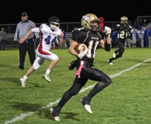 Woodland's Tom Smith (11) breaks free for a touchdown Oct. 28 versus St. Paul in Beacon Falls. St. Paul won the game, 28-19. –ELIO GUGLIOTTI
