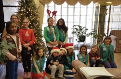 Girl Scouts from Naugatuck troops spread holiday cheer by caroling Dec. 3 at Shady Knoll Health Center in Seymour. –CONTRIBUTED