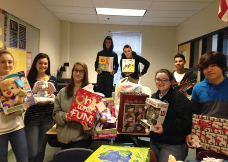 Loren Luddy's advisory at Woodland Regional High School held its 16th annual toy and gift drive recently. Teachers, staff, and students donated gifts for 40 children and families from Waterbury's Positive Parenting Program. –CONTRIBUTED