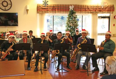 Members of the Naugatuck High School jazz band play a selection of holiday music for an audience at the Glendale Center in Naugatuck on Dec. 16. –CONTRIBUTED