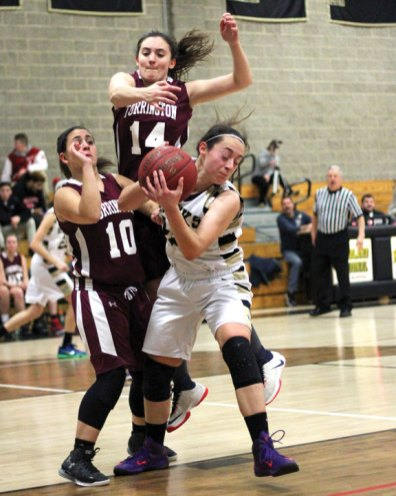 Woodland's Jenna Pannone pulls down a rebound in front of Torrington's Alexis Tyrell (10) and Sidnee Kovall (14) Monday at Woodland Regional High School in Beacon Falls. Torrington won the game, 41-36. –ELIO GUGLIOTTI