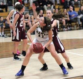 Woodland's Eliza Smith (11) eyes the basket as Torrington's Colleen Kilgore defends her Monday at Woodland Regional High School in Beacon Falls. Torrington won the game, 41-36. –ELIO GUGLIOTTI