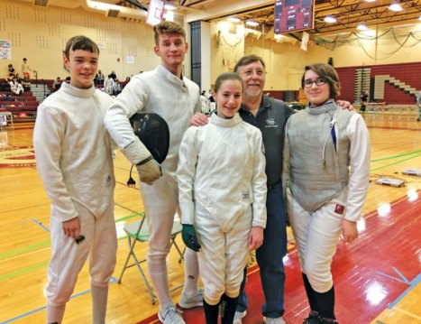 Five members of Prospect Fencing Club competed in the high school novice tournament at Guilford High School on Jan. 28. The tournament had over 180 competitors and all of the PFC members placed in the top 10 percent of the field. Cristina Catana took 15th in women's epee. Amada deLevie took sixth in women's foil. Alex Delp took fifth in men's epee. Aidan Woloszyn took first in men's epee. Harrison Brinton took first in men's foil. Placing in this tournament, qualified them to participate in the JV tournament at North Haven High School on Feb. 4. DeLevie, Delp, Woloszyn and Rebekah Wallace competed in this event. DeLevie placed 15th in women's foil. Delp placed 10th in men's epee. Wallace placed ninth in women's epee. Woloszyn took first in men's epee. Pictured, from left, Delp, Woloszyn, Wallance, Prospect Fencing Club coach Bob Rosa, and deLevie. –CONTRIBUTED