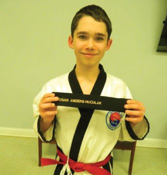 Logan Anders-Hucalak from USA Martial Arts in Naugatuck was promoted to 1st Dan Black Belt on Feb 10. –CONTRIBUTED