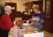 Naugatuck residents Daryl Masone, left, and Kathie Gabrielson fill bags with candy during the Trumbull-Porter Chapter Daughters of the American Revolution's tenth annual Valentines for Veterans Workshop at Grace Lutheran Church in Naugatuck Jan. 21. In total, 162 valentines and 195 individual bags of assorted candies were made for veterans at the Newington, Rocky Hill and West Haven veterans hospitals. –CONTRIBUTED