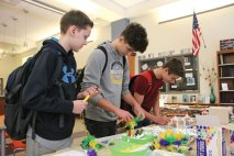Naugatuck High School freshmen, from left, Ryan Maguire, Jonah Lydon, and Dante Miranda make Brazilian carnival masks March 8 during a Cultural Expo at the school. The expo, which coincided with National Foreign Language Week, featured displays and activities related to the countries where they speak languages taught at NHS, including Spain, Mexico, France, and Italy. –LUKE MARSHALL