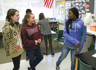 Cross Street Intermediate School fifth-grader Zahra Bayonne, right, shows off her invention, The Cleaner, to sixth-graders Emily Bailey, left, and Mikayla Thompson on March 9 during the Invention Convention at the school in Naugatuck. –LUKE MARSHALL