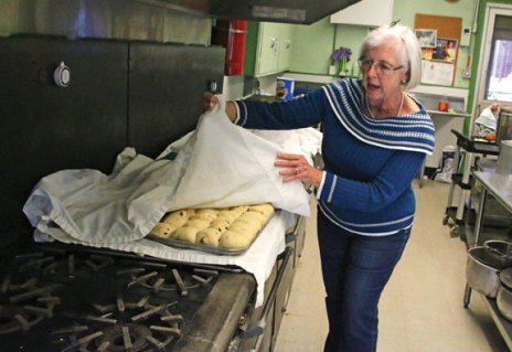 Kathy Carten checks on some baked goods for St. Michael's Church's 55th annual Lenten bakery March 2 at the church in Naugatuck. The Lenten bakery runs every Friday through April 7 at the church, 210 Church St., and is open from 12 to 3 p.m. and again from 5 to about 6 p.m. The bakery offers a variety homemade goods, including pies and hot cross buns. –LUKE MARSHALL