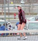 Naugatuck's Kelly Murphy lines up a shot during her match with St. Paul's Orenga Huang April 7 in Naugatuck. Naugatuck won the match, 5-2. –ELIO GUGLIOTTI