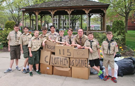 Members of Boy Scout Troop 115 from Naugatuck collected clothing on April 29 during the troop's second annual clothing drive on the Naugatuck Town Green. The troop collected 310 bags of clothing along with boxes of toys and baby items. –LUKE MARSHALL