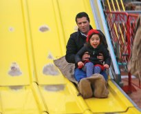 Melissa Melo, 3, of Naugatuck, rides down the slide with her father, Clayton, during the St. Francis-St. Hedwig School Spring Carnival on May 4 at the St. Francis Field on Church Street in Naugatuck. –LUKE MARSHALL