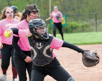Naugatuck catcher Katie Jaroneczyk throws to first for an out May 10 against Woodland at Woodland Regional High School in Beacon Falls. –ELIO GUGLIOTTI
