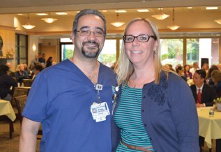 Griffin Hospital Clinical Director Kelly Egan, right, presents Edward Valente of Naugatuck with The Mary Schumacher Leadership Award during the hospital's 31st annual Nurse Day Celebration in Derby. –CONTRIBUTED