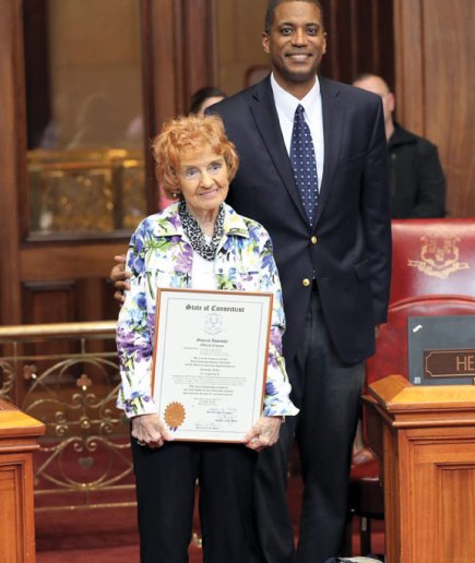 Naugatuck resident Charlotte Butler, left, was honored May 25 at the State Capitol by state Sen. George Logan for earning an associate's degree in criminal justice from Post University in May. –CONTRIBUTED