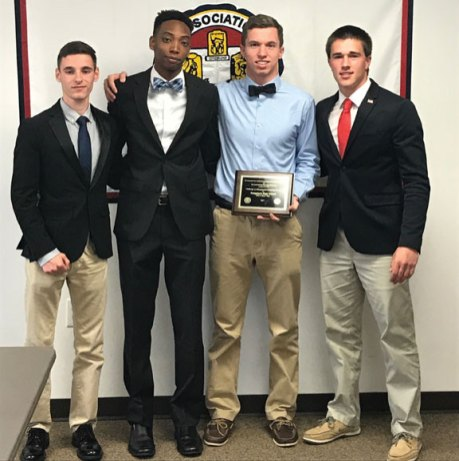 Naugatuck High School students and DECA members Joseph Dempsey, Brian Goggin and Omari Solomon were honored May 23 among the Connecticut Association of Schools' 2017 Challenge to Educational Citizenship Awards Program winners. Projects submitted for consideration for the award must demonstrate good citizenship, civic awareness and leadership and must provide opportunities for students to help others. Dempsey, Goggin and Solomon organized 'DECA Boys' Day' in January at which NHS junior and senior boys spent a day mentoring boys from fifth through eighth grade to help improve self-esteem and decision making. They were presented the award by NHS senior Tyler Deitelbaum, a member the State Student Advisory Council on Education. Pictured, from left, Dempsey, Solomon, Goggin and Deitelbaum. –CONTRIBUTED