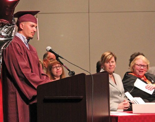 Devin Dows speaks during the Naugatuck Adult Education graduation ceremony June 1 at Naugatuck High School. Dows, 20, was one of more than 24 students to graduate from the program. –ELIO GUGLIOTTI