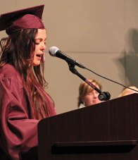 Eugenia Neto speaks during the Naugatuck Adult Education graduation ceremony June 1 at Naugatuck High School. Neto was one of more than 24 students to graduate from the program. –ELIO GUGLIOTTI