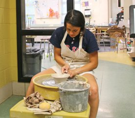 Woodland Regional High School senior Samantha Plasky puts on a pottery wheel demonstration on May 25 during the school's annual Summer Fine Arts Night at the school in Beacon Falls. The night featured artwork by students, demonstrations as well as theatrical and musical performances. Kristen Lengyel, a visual arts teacher and chairman of the fine arts department, said about 150 students participated in the event. –LUKE MARSHALL