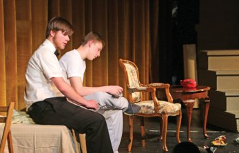 Woodland Regional High School students Jacob Marks, left, and Riley Clark, perform a scene from Neil Simon's 'Odd Couple' on May 25 during the school's annual Summer Fine Arts Night at the school in Beacon Falls. The night featured artwork by students, demonstrations as well as theatrical and musical performances. Kristen Lengyel, a visual arts teacher and chairman of the fine arts department, said about 150 students participated in the event. –LUKE MARSHALL