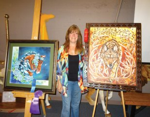 Artist Kiki Michalek, of Naugatuck, recently won three awards for two paintings she entered in the 19th annual Woodcarvers and Art Show on June 3 at the Carousel Museum of New England in Bristol. Michalek won second place for 'Wolf,' and first place for 'Midnight Rose' in their respective classes. 'Midnight Rose' also won Best of Show. -CONTRIBUTED