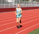 Jackie Uva, 13, of Naugatuck, runs around the track at Naugatuck High School during a mini-triathlon Auf. 1. The triathlon was part of a six-week Race4Chase Kid's Triathlon program hosted by the Naugatuck YMCA. The program, which was founded to celebrate the life of Chase Kowalski who was one of the students killed during the shooting at Sandy Hook Elementary School in 2012, concluded with a triathlon at YMCA Camp Sloper in Southington on Aug. 5. –LUKE MARSHALL