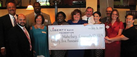 The Liberty Bank Foundation recently awarded $22,500 in grants to agencies representing the Naugatuck Valley. Pictured, from left, Liberty Bank President and CEO Chandler Howard; Jered Bruzas from the St. Vincent DePaul Mission of Waterbury, David Dudley from New Opportunities, Inc./Shelter Now, Kathi Crowe from Waterbury Youth Services, Calida Jone from Waterbury Symphony Orchestra, Joy DeMarchis from BH Care/Umbrella Center for Domestic Violence Services, James Purvis from Salvation Army Emergency Shelter for Families, Karen Mello from United Way of Greater Waterbury, Lee Schlesinger from Safe Haven of Greater Waterbury, JoAnn Reynolds-Balanda from United Way of Greater Waterbury, and Lisa Pytka, general manager of Brass City Bistro. –CONTRIBUTED