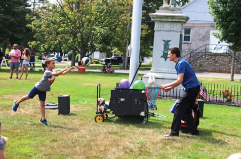 Colby Marsan, 8, of Prospect, throws a ball to juggler Bryson Lang on Aug. 21 on the Prospect Green during the first day of Mayor Bob's Annual Fun Week, which featured a variety of entertainment, games and food for school children all week long. –LUKE MARSHALL