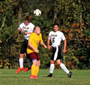 Woodland's George Hughes goes up over Sacred Heart's Evan LaFerriere to try to head the ball Oct. 13 at Woodland Regional High School in Beacon Falls. Woodland won the game, 4-1. –ELIO GUGLIOTTI