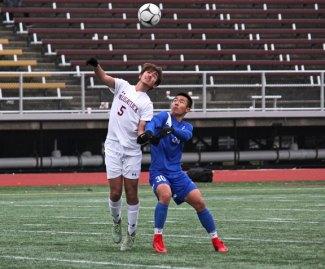 Naugatuck's Christian Jacobi (5) battles with Glastonbury's Jiyoo Son (30) for the ball during the Class LL championship game Saturday in New Britain. Glastonbury won the game, 1-0. –ELIO GUGLIOTTI