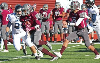 Naugatuck's Doreon Chapman (4) breaks loose for a 69-yard touchdown run versus Ansonia Thanksgiving morning at Naugatuck High School. Ansonia won the game, 46-28. –ELIO GUGLIOTTI