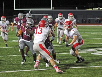 Naugatuck's Efe Onakpoma (44) runs up the field versus Wolcott Nov. 3 at Naugatuck High School. Naugatuck won the game, 61-22. –ELIO GUGLIOTTI