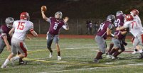 Naugatuck's Mike Plasky throws a touchdown versus Wolcott Nov. 3 at Naugatuck High School. Naugatuck won the game, 61-22. –KEN MORSE