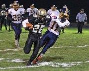 Woodland's Ben Nuss (28) stiff-arms Kennedy's Akiel Lindo (11) Nov. 9 at Woodland Regional High School in Beacon Falls. Woodland won the game, 49-12. –ELIO GUGLIOTTI