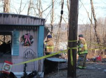 Firefighters work at the scene of a mobile home fire at 7 Shadduck Road in Naugatuck on Friday morning. A man died in the blaze. –ELIO GUGLIOTTI