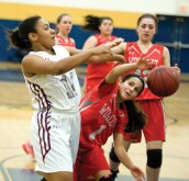 Naugatuck's Alexis Woods (14) and Wolcott's Emiah Soto (1) battle for a loose ball during a NVL semifinal game Monday at Kennedy High School in Waterbury. Naugatuck won, 45-36. -JIM SHANNON/REPUBLICAN-AMERICAN
