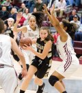 Woodland's Eliza Smith (11) drives to the basket on Naugatuck's Alexis Woods (14) Tuesday at Naugatuck High School. Naugatuck won the game, 51-23. -JIM SHANNON/REPUBLICAN-AMERICAN