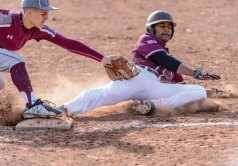 Naugatuck's Jonathon Chatfield (13) tags out Sacred Heart's Justin Stephens (2) at third base Monday at Fulton Park in Waterbury. Sacred Heart won the game, 6-2. -BILL SHETTLE/REPUBLICAN-AMERICAN