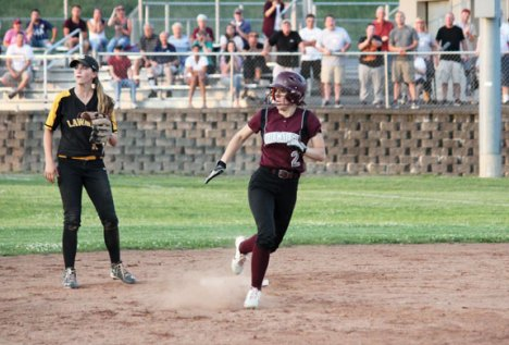Naugatuck's Megan Schofield checks out where the ball is in the outfield as she rounds second before heading to third base versus Jonathan Law during a Class L quarterfinal game June 1 at Naugatuck High School. Jonathan Law won, 5-2. -ELIO GUGLIOTTI