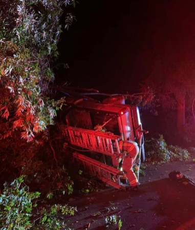 A firefighter works at the scene of a crash on Webb Road in Naugatuck Sunday night. –CONTRIBUTED