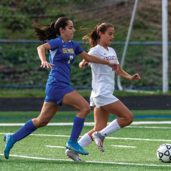 Naugatuck's Lauren Sonski (18) and Seymour's Suzana Imetovski (7) run down a loose ball during a match Oct. 19 at Seymour High School. Sonski was one of eight Naugatuck and Woodland soccer players to earn All-State honors in the fall. -JIM SHANNON/REPUBLICAN-AMERICAN
